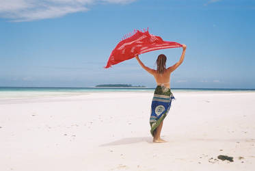 Lady and red sarong on a beach by WhyJP