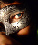 Behind the silver mask