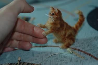 Miniature orange tabby cat sculpture