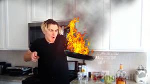 Luke setting the food on fire