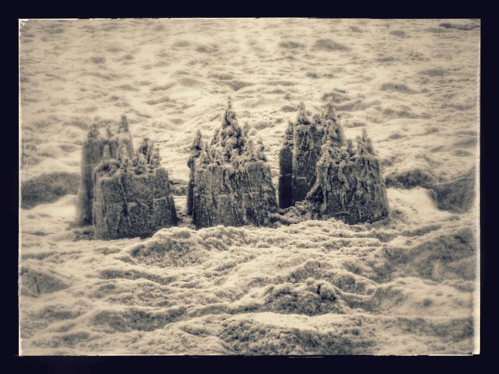 Crumbling Sandcastles by TiffaniMariel
