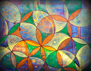 orange flower of life with blue n green