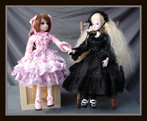 Mirabel And Cecelia dolly buddies, framed