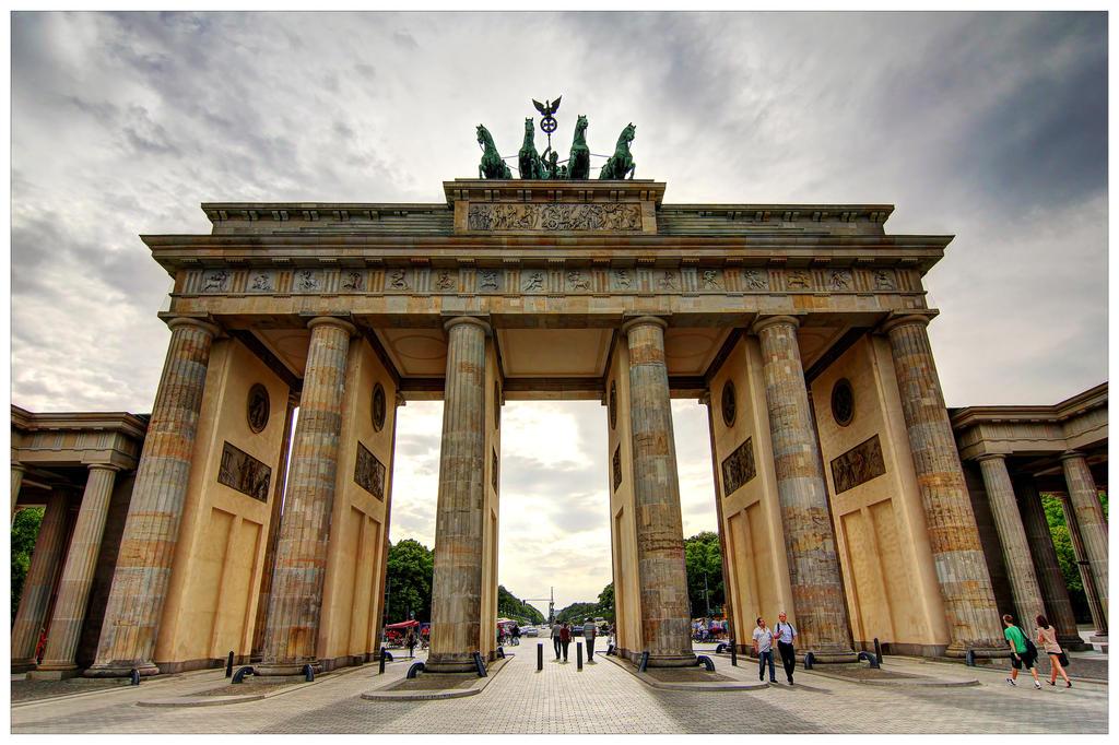 Check out the historical brandenburg gate in germany for Design hotel brandenburg