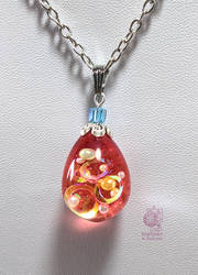 The red drop of crystal rings