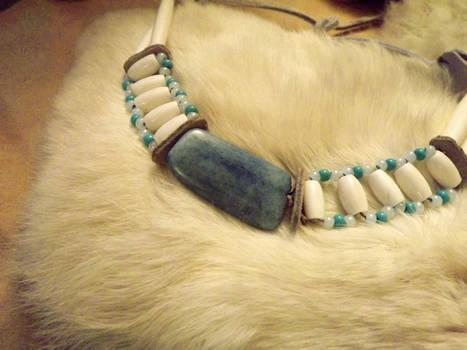 Blue bone accent 1800's Regalia, closeup