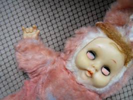 Spooky pink satanist doll