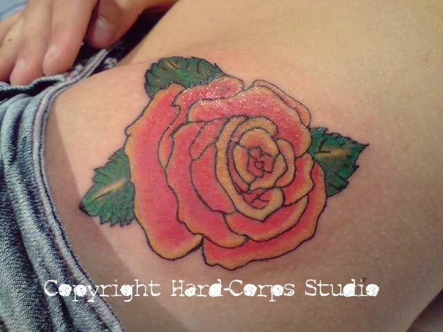 Rose tattoo on the hip by HardCorpsStudio on deviantART