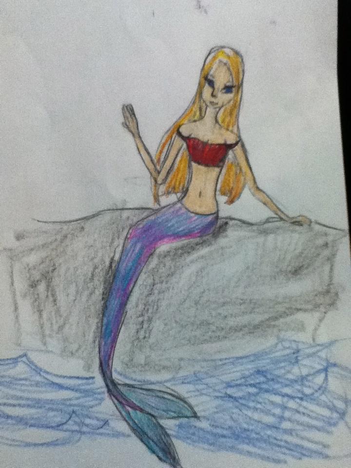 mermaid sitting on a rock by lemondropiesluvr