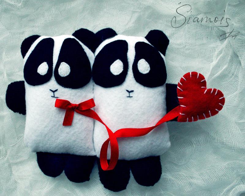 siamese pandas by TroubleNight