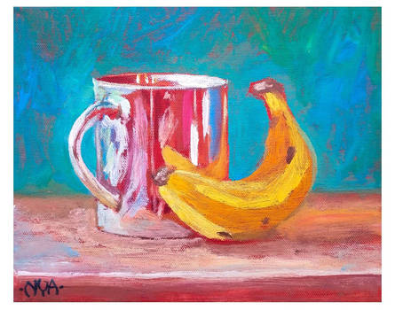 stilllife with chrome cup and banana