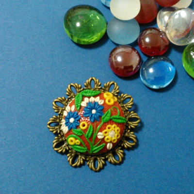 Broche con motivos florales de FIMO by PatriciaSaavedra