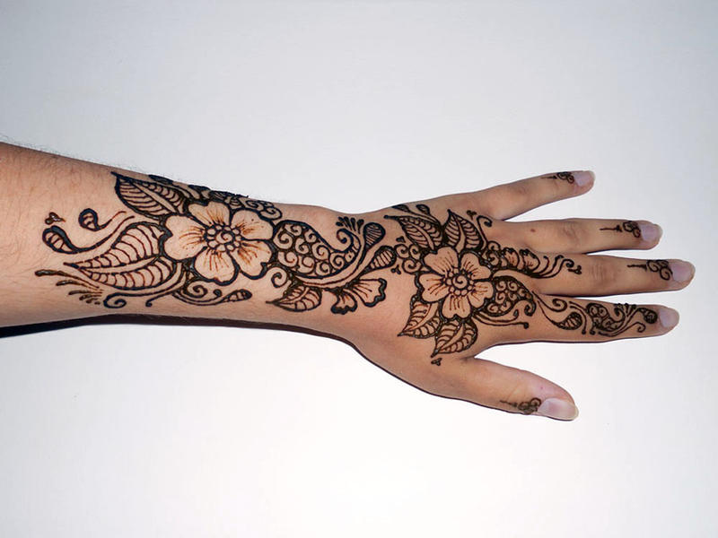 Henna floral hand by warriorwhite on deviantart for Flower tattoos on hand