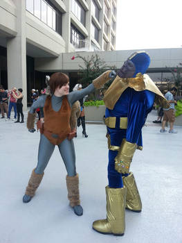 Squirrel Girl beating up Thanos