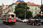 Old tram and old automobile