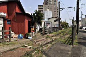 A rusty railway runs in backyard by Furuhashi335