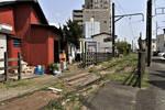 A rusty railway runs in backyard