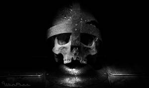 Skull and helmet on shield