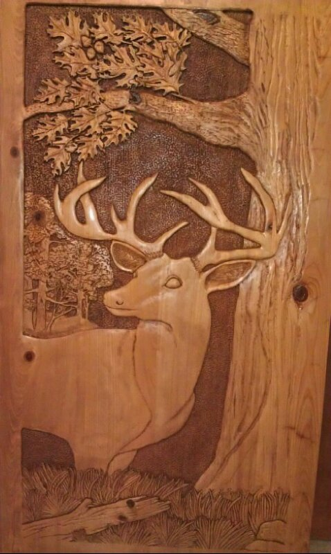 Wood carving of deer buck among the oaks and quo by