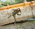 Marina and rusty boat