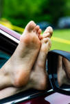 Car window and feet by JonMann