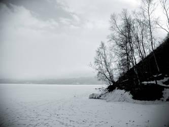 snow on lake by Hrymmskrymnir