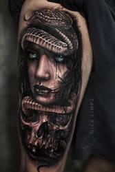 Skull girl snake tattoo