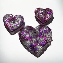 Purple resin hearts by Chibi-Sugar