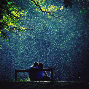 Love beneath the showery clouds