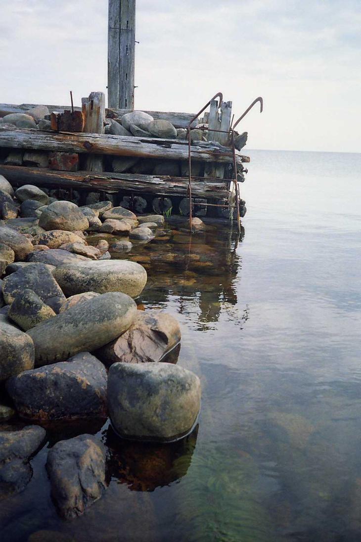 old pier broken by ice by piraaja
