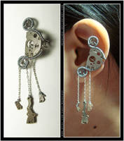 Steampunk Gibbous Moon ear cuff by Meowchee