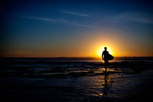 Mission Beach Surfer at Sunset by ejmcgowan