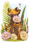 Crested gecko in fowers