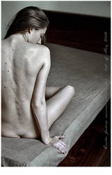 'E' nude on the bed by ostanine