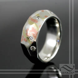 Mixed Metal hand forged and Faceted band