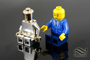 A solid gold and silver Lego Man