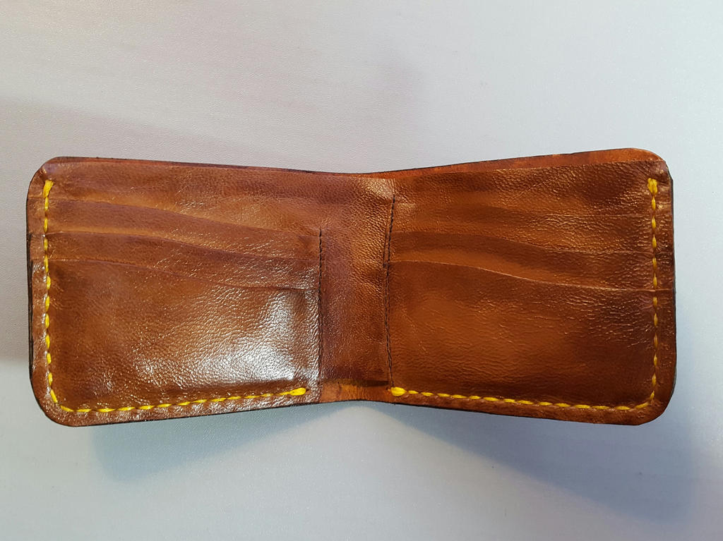 Inside of charmander and charizard leather wallet by Bubblypies