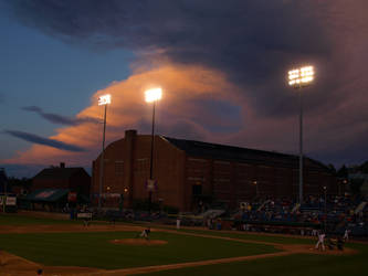 Sunset over Hadlock Field by RavenTheTrickster