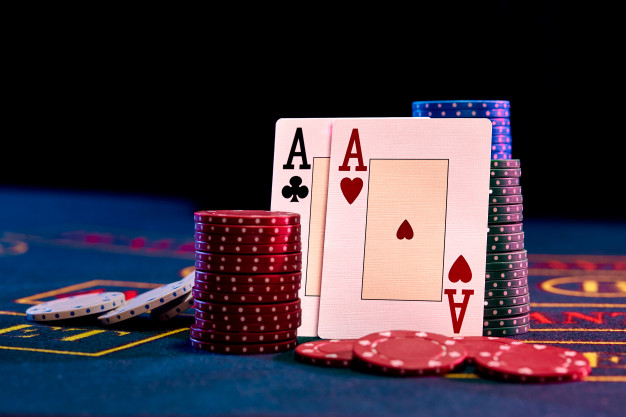 Two-aces-standing-leaning-chips-piles 157927-10