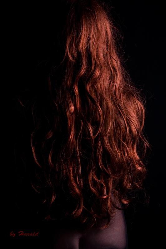 Redhead in blackshirt by HaraldW