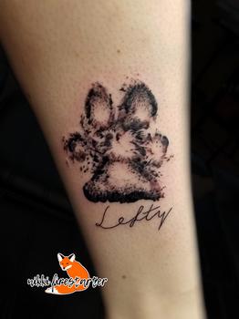 Lefty Paw Print Tattoo