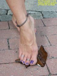 Paloma's feet on broken glass by Feetosopher