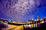 fisheye view of a city at night with clouds