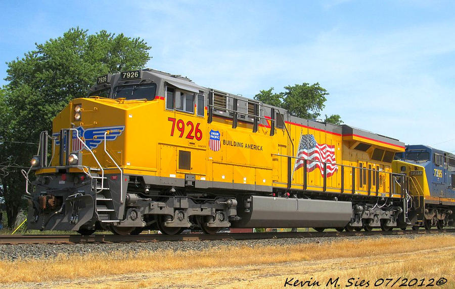Brand Spankin New UP 7926 leading CSXT Q686 18 by EternalFlame1891