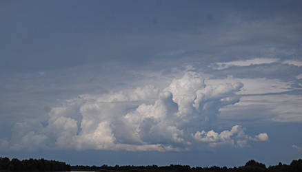 big cloud on the horizon by amka-stock