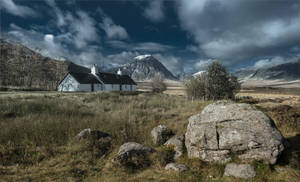 a lonely house on a background highlands