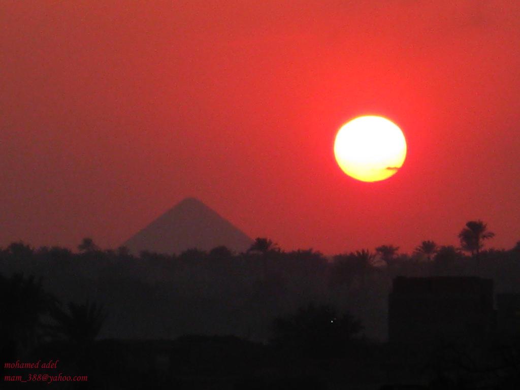 sunset by senfru s pyarmid by Creativemohamedadel