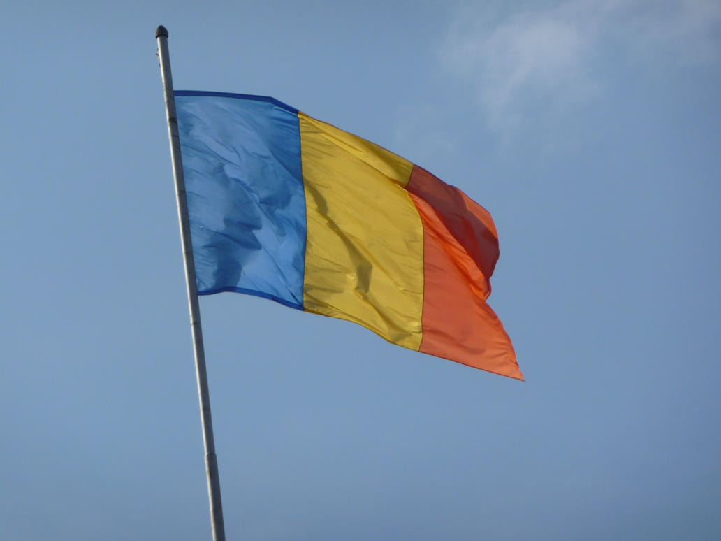 Romania National tricolor flag on clear Bucharest by Rikitza