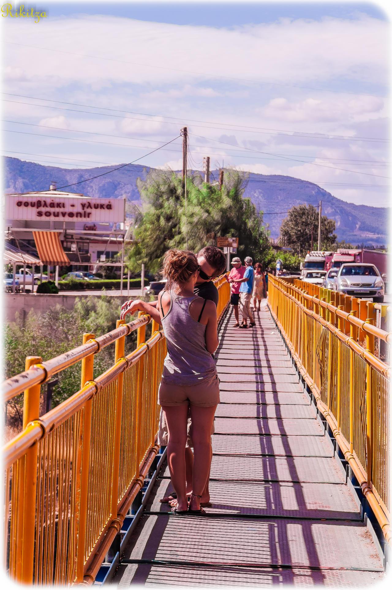 kiss on yellow bridge by Rikitza
