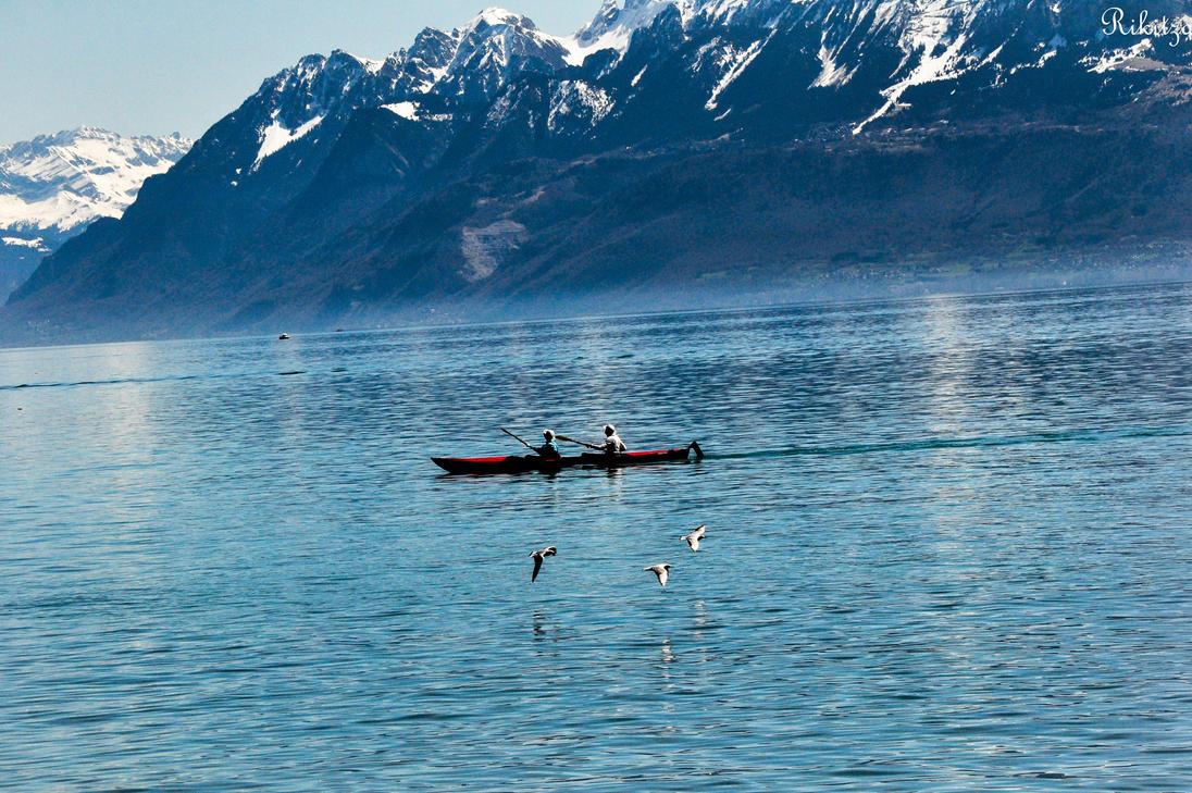 Kayak and birds on Geneva lake by Rikitza
